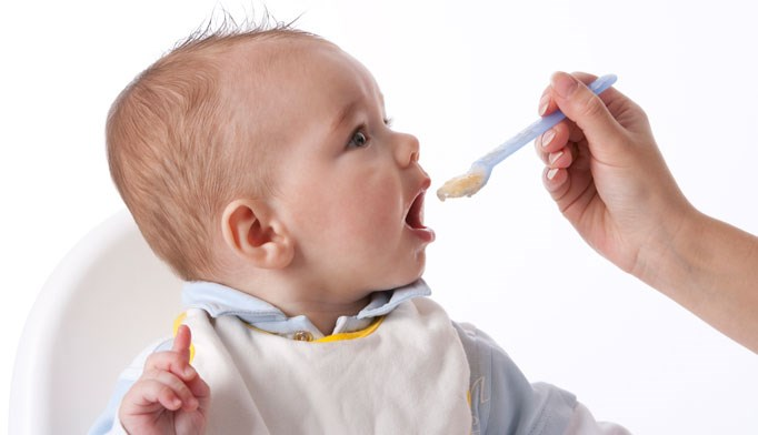 Many moms start infants on solid foods too early