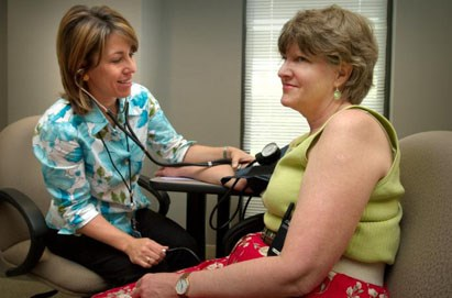 Patient having her blood pressure taken. Photo credit: James Gathany/CDC
