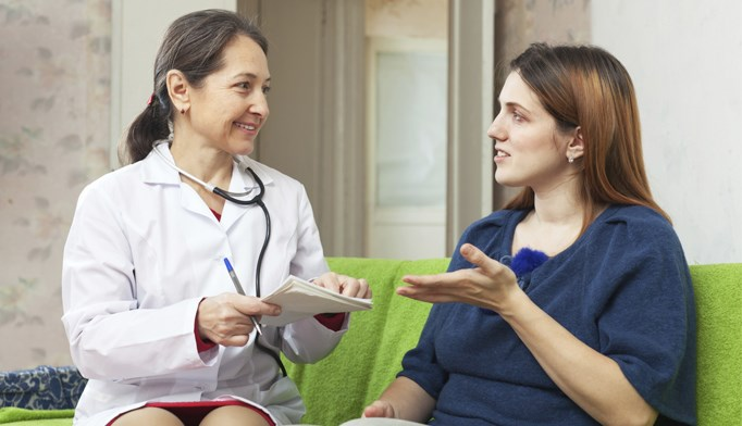 A patient talks with a provider about psoriasis treatment