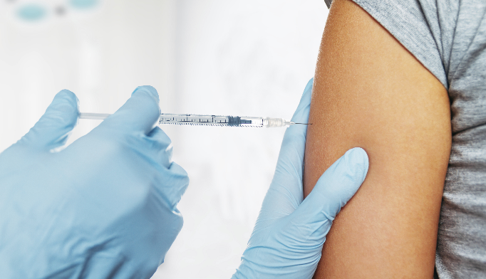 Easing pain during vaccination