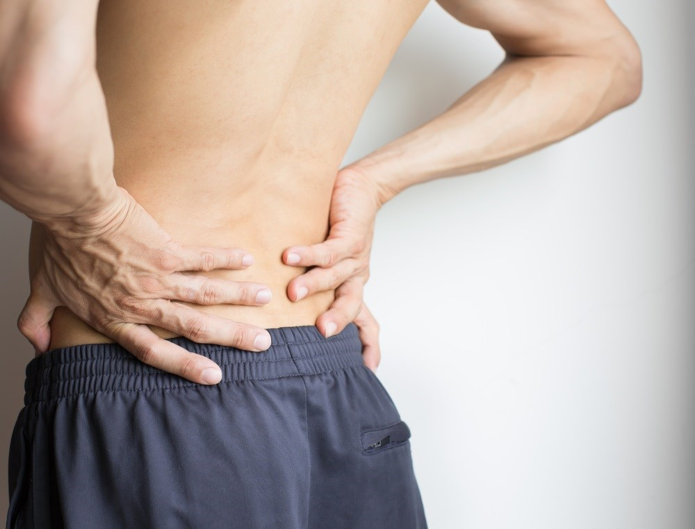 Dorsal Root Ganglion Stimulation Disrupts Back Pain