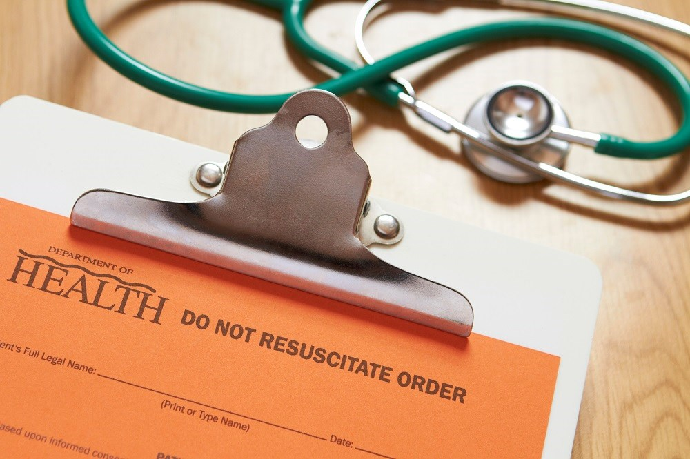 "Should a ""do not resuscitate"" tattoo on an unconscious patient be honored?"